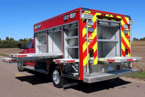 Fire truck with custom compartments and work stations